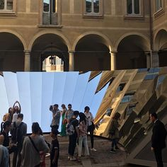 by axmurphyAmerican artist Phillip K. Smith III, designed a faceted mirror structure which was installed in the courtyard of a 16th-century palazzo.  The intent of the structure, designed on behalf of COS, was to pull the sky to the ground and encouraged viewers to interact with the architecture. . . #opensky #openskyexperience #art #milandesignweek2018 #mirror #facetedmirror #adifferentview #perspective #cos #phillipksmithiii #palazzo #art #interactiveart