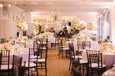 Tall and low arrangements  of white hydrangea and pink roses