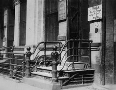 Child labor, boy wanted sign, reads 'Wanted Small Boys, apply 1st floor, N.Y. Button works', West 19th Street, New York City, photograph by Lewis Wickes Hine, March, 1916