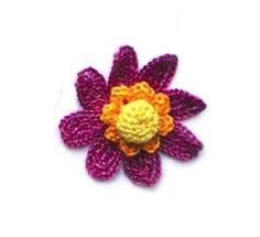 ...flower with a double center and eight petals; see number 06 *