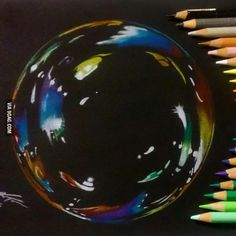 Bubble drawing on black paper.