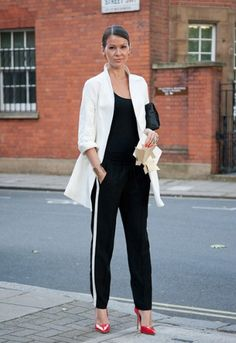 A chic monochrome outfit is livened up with some killer red stilettos.