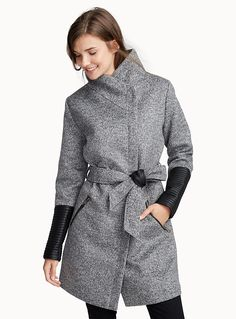Exclusively from Twik - The fall coat is updated with a high cocoon neck and supple faux-leather sleeves - Comfortable stand-up collar - Matching tie belt - Slant front pockets - Full-length zip hidden under a placket The model is wearing size small