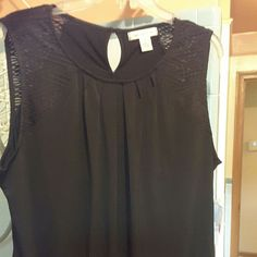 Black dressy top Dressy top great to dress up or down . New with tags on it, scoop neck. SIZE XL Worthington Tops Blouses