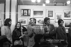 """CHRIS STEELE-PERKINS, MARGO HAPGOOD, BRYN CAMPBELL, LEWIS AMBLER, MARK HAWORTH-BOOTH The Photographers Gallery Great Newport Street London 1971. """"Co Optic"""" Christmas Print Auction. L-R Chris Steele-Perkins, Margo Hapgood from Time Life Books. Bryn Campbell, Lewis Ambler who ran Travelling Light's mounting and framing operation, Mark Haworth-Booth."""