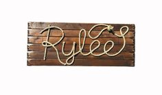 "32"" Medium Stain Wood Plank Background.  Lasso Rope Accent Name: Rylee"