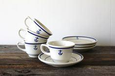 Vintage US Navy Wardroom coffee set..I know where to find a whole set! Would be cute hung in the kitchen on hooks.
