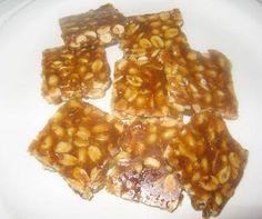 Moongphali Chikki (Peanut Brittle) - A quick snack made with roasted peanuts and caramel syrup. Indian Desserts, Indian Sweets, Sweet Desserts, Sweet Recipes, Dessert Recipes, Indian Dishes, Microwave Cupcake, Microwave Recipes, Cooking Recipes