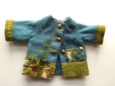 """I think I put this image on to Facebook some time ago to hint that in a few months time I will be a Grandmother! The jacket was """"found"""". I don't know whether it was a child's jacket or one for a doll."""