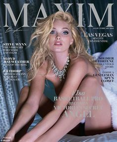 She's no Angel! Elsa Hoskis pictured on the cover of February's magazine, apparently naked except for a ostentatious diamond necklace