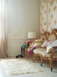 Scrumptiously padded wall, a gilded settee, silk draperies - Parisian opulence