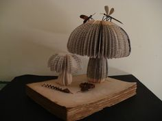 I love mushrooms, and these ones made out of old books are very cute. The pages are reminiscent of the gills of mature mushroom caps. Book sculpture by Clara Maffei