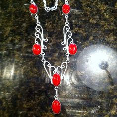 Coral necklace.  Marked 925! Awesome Coral Necklace marked 925!  The stones are authentic.  My mom and I have been going to a gem show every summer for several years and I am trying to sell a few pieces so I can get new ones.  Look at my closet!  I offer bundle discounts! Jewelry Necklaces