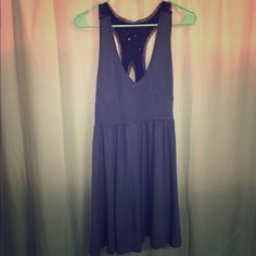 URBAN OUTFITTERS blue dress URBAN OUTFITTERS blue dress with beaded back detail. Jersey material. Very flattering. V-neck. Casual with a little flare. In excellent condition!!  Urban Outfitters Dresses Midi