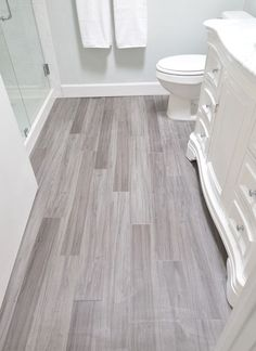 small bathroom!! vinyl plank bathroom floor ... budget friendly modern vinyl plank product. These are Trafficmaster Allure in Grey Maple installed in a random offset pattern like hardwood. Available at Home Depot,
