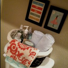 My turquoise and orange bathroom decor. I Love Amy Butler patterns and LoveKacie wall art!