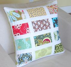 chutes de tissus et biais ...housse de coussin ou plaid !! -nice way to feature lovely fabric scraps