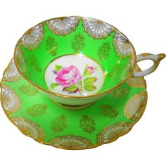 Paragon china, made in England. Fabulous bright lime green and Ornate fan like gold gilt Tea cup and saucer. Embellished with slightly raised pink