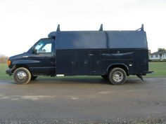 2005 FORD E-450 SD DIESEL CUTAWAY UTILITY VAN. Powered by a 6.0 Powerstroke Diesel Engine. Automatic Transmission, Air Conditioning, 13 foot Knapheide Utility Body w/Ladder Racks, Tow Package, 14,500 GVW, 94K Actual Miles.