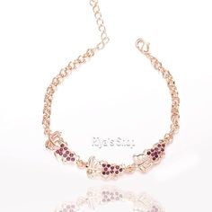 18K gold plated rhinestone fruit bracelet Material: 18K gold plated, shape: grapes , Metal: tin alloy, anti-allergic, lead and nickel compliant Jewelry Bracelets