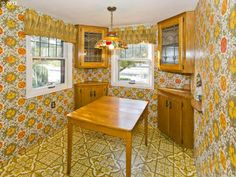 Colorful patterns on both the floors and the walls were a popular way to decorate in the 1930s (though we can't be sure whether the decor here dates back that far; the house did change a bit through the decades). The leaded glass cabinets are original to the home.  #1930s