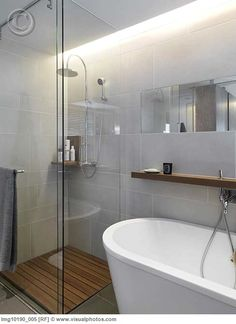 glass enclosure + wood floor --> make the doors fold in to save space when not using the shower
