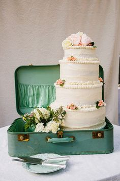 Could easily style the two tier cake like this in a suitcase with the bouquet and take a shot similar to this one
