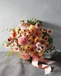 Here, floral designer Ariella Chezar added pastel dahlias into a soft, sweet mix of zinnias, scabiosas, eucalyptus, blushing brides,…