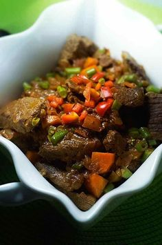 Zimbabwean beef stew (nyama) is a simple dish typically served with sadza, a porridge made with cornmeal. #christmas #zimbabwe #196flavors