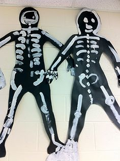 Skeletons: Lessons About Bones - paint on black butcher paper