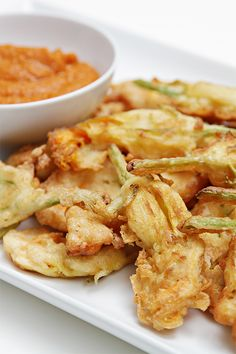 Beer-battered zucchini flower fritters with curried tomato coulis #summer #vegetarian #snacks #recipes #fingerfood #appetizer