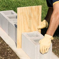 Every great home improvement plan starts with the basics. Learn how to set a solid base for a concrete block wall and lay out a strong foundation. Concrete Retaining Walls, Concrete Block Walls, Cinder Block Walls, Concrete Footings, Poured Concrete, Concrete Wall, Concrete Walkway, Concrete Building, Concrete Block Foundation