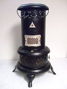 My Hubby electrified our heater & used a 'flicker bulb' to replicate a flame. It is really sweet lit up in a dark room. Portable Heater, Portable Stove, Oil Heater, Kerosene Heater, Booth Decor, Antique Stove, Vintage Stoves, Blacksmith Tools, Cooking Stove
