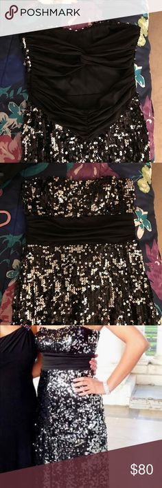 """Silver and black sequined strapless prom dress Silver and black sequined prom dress. Strapless fit with cut out on the back and floor length. Size medium (I was 125 and 5'7"""" while wearing this and fit perfectly) I bought this at Dillard's Dresses Prom"""