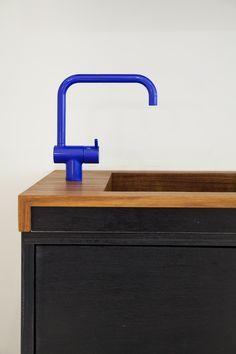 The iconic Arne Jacobsen faucet, commissioned by Vola in 1961, is currently available in six different colors, as well as stainless steel and chrome, through the Danish Design Store. We spotted the blue KV1 model in a display put together by the much-loved store Mjölk in Toronto.
