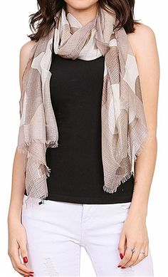 Does your summer outfit need a little something extra? Throw on the Major Style Camouflage Scarf to instantly get a chic, summer look. Find this brown, lightweight scarf at Wild Lilies Jewelry. #camouflage #scarf #scarftrends #brownscarf #summerstyle #fashion