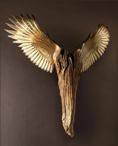 Nike Of The Forest wood sculpture by Jason Tennant,