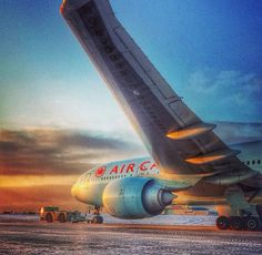Air Canada Boeing 777-B777/ER C-FIUV getting a tow in the snow.