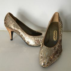 Sequin heels! Fabulous! To small for me. My feet have grown over the years. Sequins never go out of style! Totally Cinderella! Gown or tiny weeny skimpy black dress! Your call!!! Impo Shoes