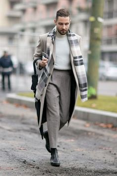 The men's edition of Milan fashion week kicked off in suitably chilly weather. Ushering in the fall / winter 2015 collections, the show attendees opted for a mix of styles, from monochrome suited l. Fashion Jobs, Men's Fashion, Trendy Fashion, Milan Fashion, Fashion Websites, College Fashion, Fashion Clothes, Korean Fashion, Winter Fashion