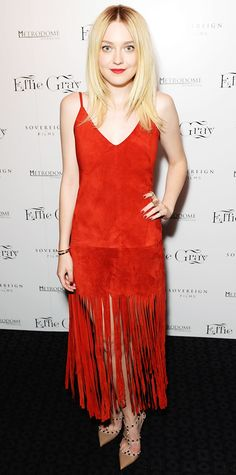 Dakota Fanning had fun with fringe at the Effie Gray premiere, selecting a vibrant red suede fringe Valentino number with studded nude Valentino pumps.