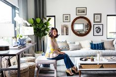 After spending an entire year renovating our newly purchased home, my husband and I found ourselves hittinga visionaryroadblockwhen it came to furnishing one of the most important and multi-functionalspaces: the living room. This open area posed a bevy of challenges for us, oneof which