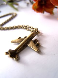 the jetplane necklace.. $9.00, via barberryandlace on Etsy | want this airplane pendant necklace