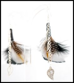 Handmade by Vicki Dempster - Check out this item in my Etsy shop https://www.etsy.com/uk/listing/262369522/feather-earrings-with-leaf-charms