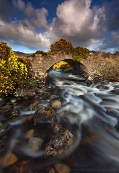 Photograph Dunlewy Stone Bridge by Stephen Emerson on 500px.Another composition from that little stone bridge that leads across the river into The Poisoned Glen in Co Donegal, Ireland,  Wellington boots are a wonderful thing for the landscape photographer but they are heavy and sweat your feet. If I leave without them I usually regret it.