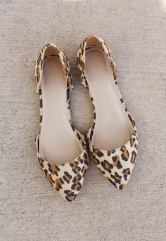 """You were born to lead!These Follow Me Leopard Flats feature faux suede in a darling cheetah print. Ballet flat styling with a pointed toe and D'orsay styling. Cushioned insole and rubber bottom sole with nonskid markings. Slip-on style.*Man Made Materials*3"""" Shaft Height*0.25"""" Heel Height*Imported"""