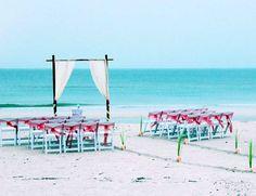 Florida beach wedding - by Suncoast Weddings -  A two post arch with a drape and a twist
