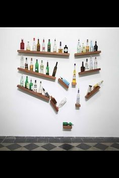 """VERY creative """"falling bottles"""" shelf display. 
