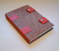 Handmade book bound in wood and red leather by JonathanDayBookArt