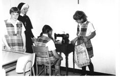 Sister Mary Alan Miller teaches sewing vocational skills at Mary Immaculate School in the early 1960's. Mary Immaculate School was the only Catholic elementary school in Toledo devoted to girls and boys with academic and physical disabilities. #HistoryNun #NCSW http://www.sndtoledo.org